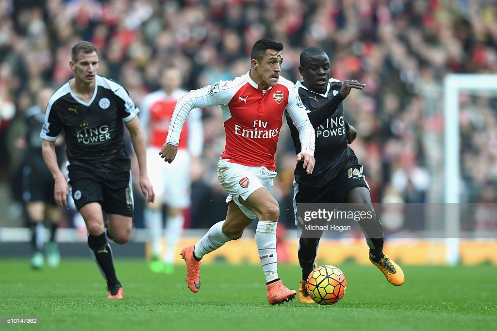 Alexis Sanchez of Arsenal takes on N'golo Kante of Leicester City during the Barclays Premier League match between Arsenal and Leicester City at the Emirates Stadium.