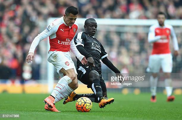 Alexis Sanchez of Arsenal takes on N'golo Kante of Leicester City during the Barclays Premier League match between Arsenal and Leicester City at the...