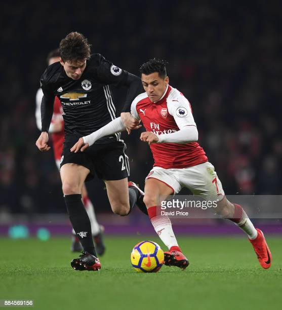 Alexis Sanchez of Arsenal takes on Victor Lindelof of Man Utd during the Premier League match between Arsenal and Manchester United at Emirates...