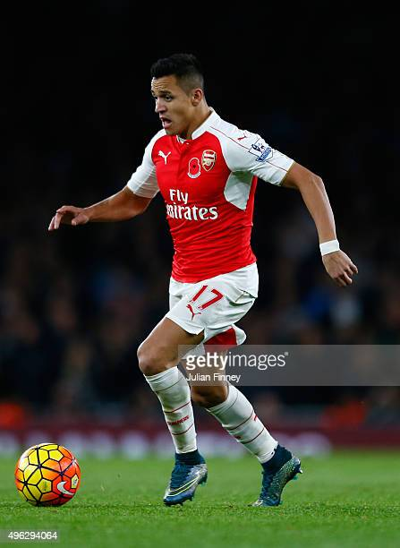 Alexis Sanchez of Arsenal takes the ball forward during the Barclays Premier League match between Arsenal and Tottenham Hotspur at the Emirates...