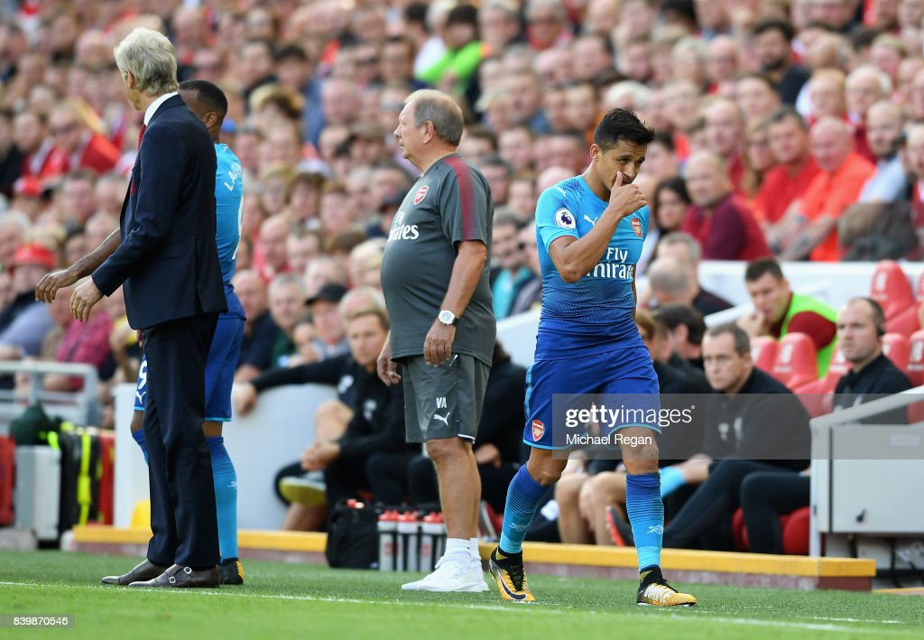 Alexis Sanchez of Arsenal walks off after being subbed during the Premier League match between Liverpool and Arsenal at Anfield on August 27, 2017 in Liverpool, England.