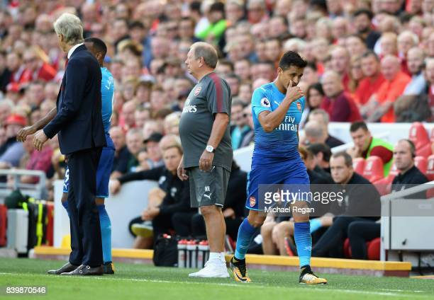 Alexis Sanchez of Arsenal walks off after being subbed during the Premier League match between Liverpool and Arsenal at Anfield on August 27 2017 in...