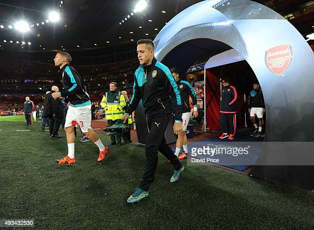 Alexis Sanchez of Arsenal walks out to warm up before the UEFA Champions League match between Arsenal and Bayern Munich at Emirates Stadium on...