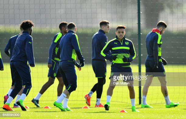 Alexis Sanchez of Arsenal warms up with his team mates during a training session at London Colney on March 6 2017 in St Albans England