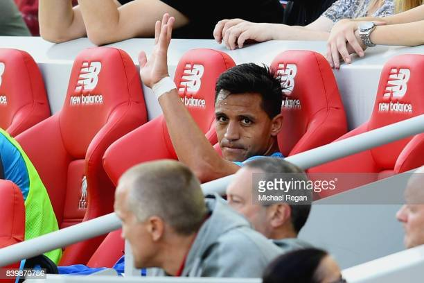 Alexis Sanchez of Arsenal waves after being subbed during the Premier League match between Liverpool and Arsenal at Anfield on August 27 2017 in...