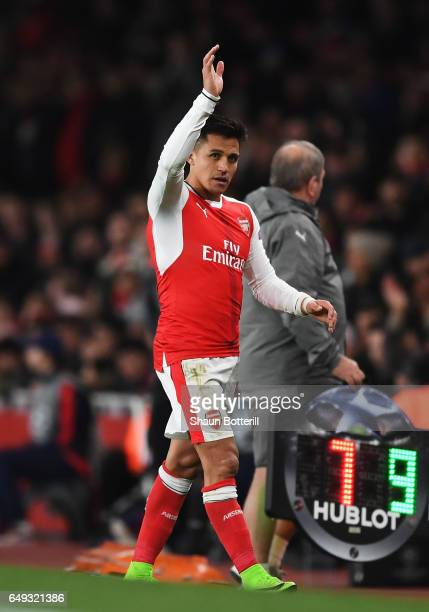Alexis Sanchez of Arsenal waves to the crowd as he is substituted during the UEFA Champions League Round of 16 second leg match between Arsenal FC...
