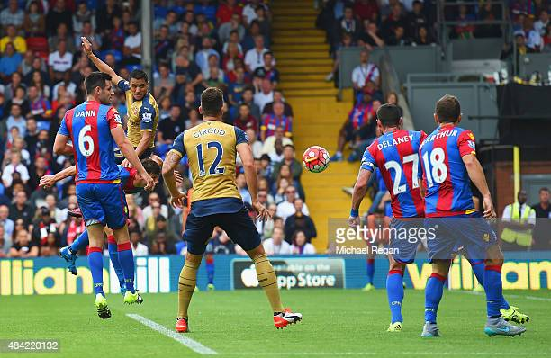 Alexis Sanchez of Arsenal wins a header leading to the own goal scored by Damien Delaney of Crystal Palace during the Barclays Premier League match...