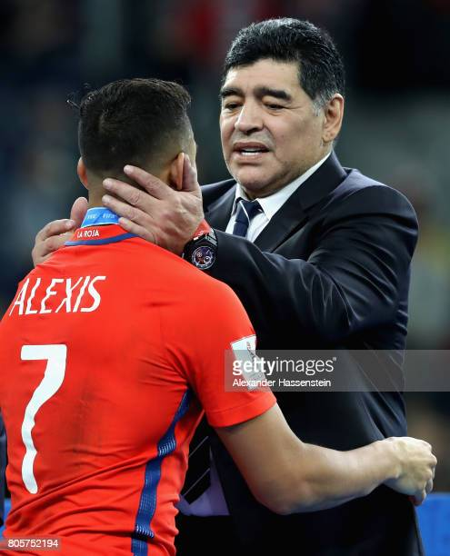 Alexis Sanchez of Chile and Diego Maradona embrace after the FIFA Confederations Cup Russia 2017 Final between Chile and Germany at Saint Petersburg...
