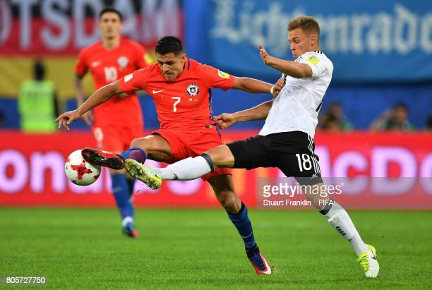 Alexis Sanchez of Chile and Joshua Kimmich of Germany battle for possession during the FIFA Confederations Cup Russia 2017 Final between Chile and...