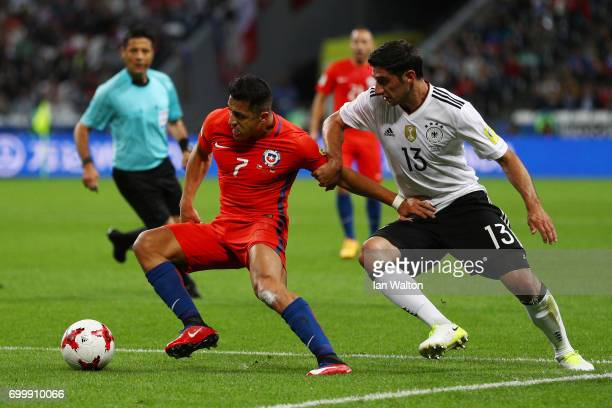 Alexis Sanchez of Chile and Lars Stindl of Germany battle for possession during the FIFA Confederations Cup Russia 2017 Group B match between Germany...