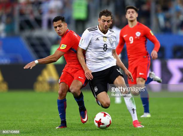Alexis Sanchez of Chile and Leon Goretzka of Germany battle for possession during the FIFA Confederations Cup Russia 2017 Final between Chile and...