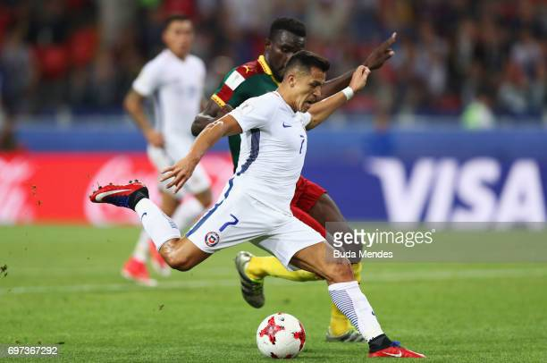 Alexis Sanchez of Chile and Michael NgadeuNgadjui of Cameroon compete for the ball during the FIFA Confederations Cup Russia 2017 Group B match...