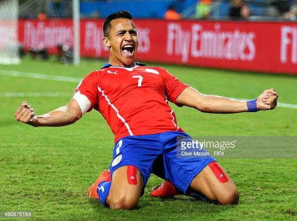 Alexis Sanchez of Chile celebrates after scoring a goal during the 2014 FIFA World Cup Brazil Group B match between Chile and Australia at Arena...