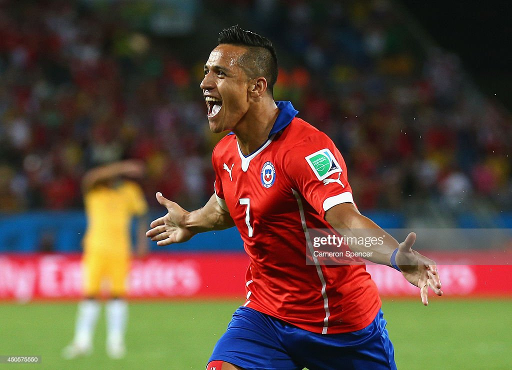 Alexis Sanchez of Chile celebrates after scoring his team's first goal during the 2014 FIFA World Cup Brazil Group B match between Chile and...