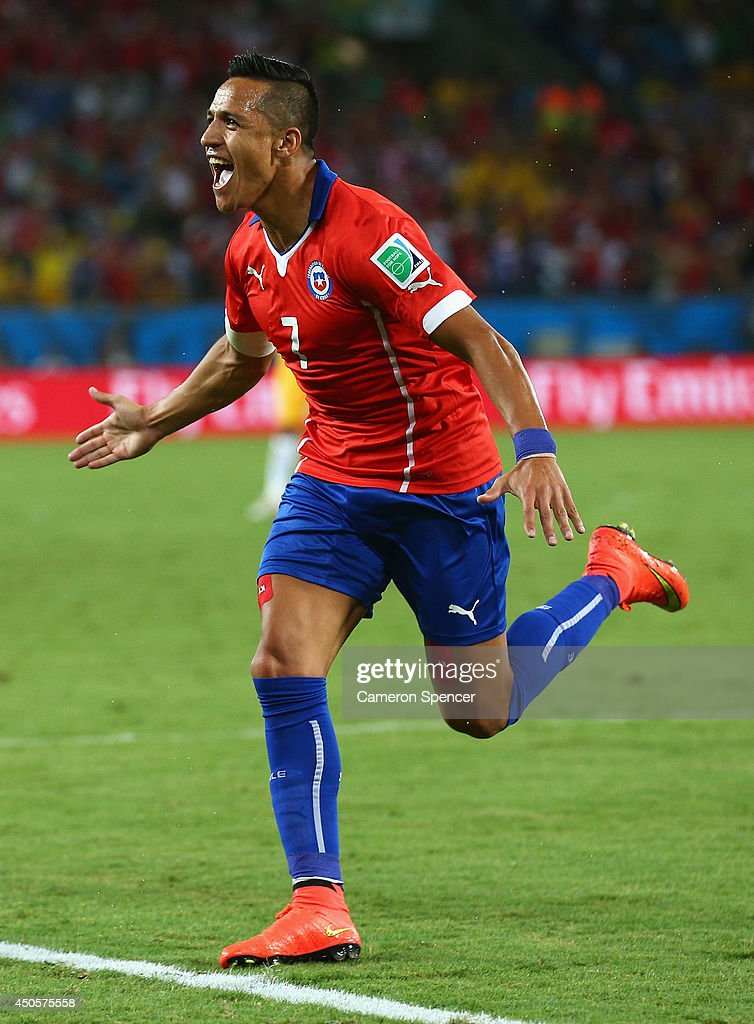 Alexis Sanchez of Chile celebrates after scoring his team's first goal during the 2014 FIFA World Cup Brazil Group B match between Chile and Australia at Arena Pantanal on June 13, 2014 in Cuiaba, Brazil.