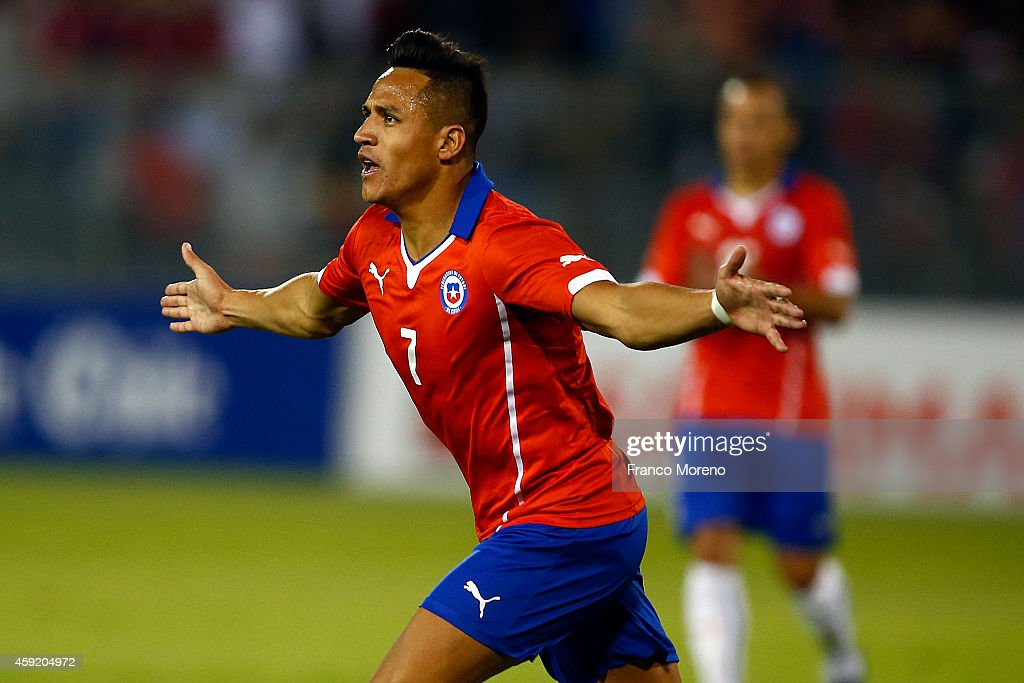 Alexis Sanchez of Chile celebrates after scoring the first goal of his team during an international friendly match between Chile and Uruguay at...