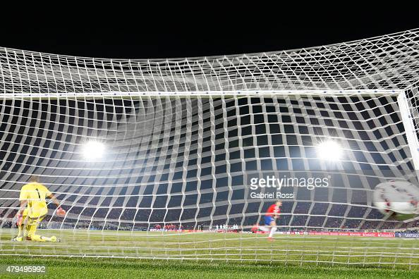 Alexis Sanchez of Chile celebrates after scoring the fourth penalty in the penalty shootout during the 2015 Copa America Chile Final match between...