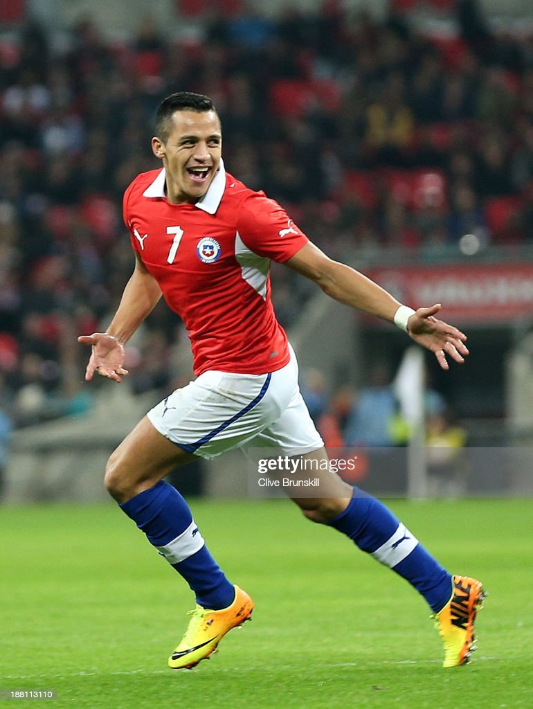 Alexis Sanchez of Chile celebrates after scoring the opening goal during the international friendly match between England and Chile at Wembley Stadium on November 15, 2013 in London, England.