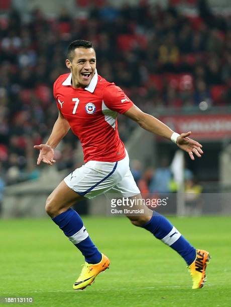 Alexis Sanchez of Chile celebrates after scoring the opening goal during the international friendly match between England and Chile at Wembley...