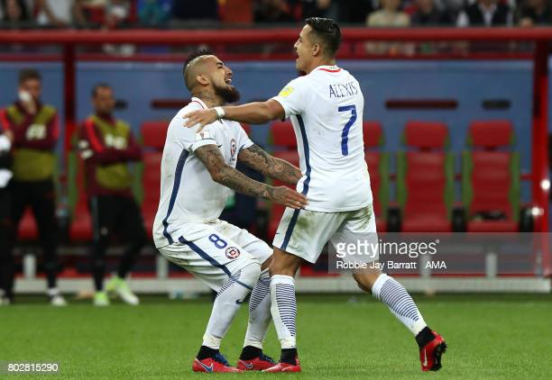 Alexis Sanchez of Chile celebrates scoring a penalty in a shootout ith Arturo Vidal during the FIFA Confederations Cup Russia 2017 SemiFinal match...