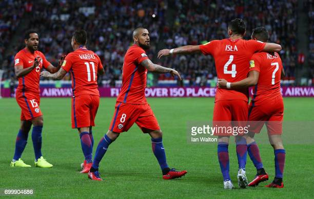 Alexis Sanchez of Chile celebrates scoring his siwdes first goal ith Mauricio Isla of Chile and Arturo Vidal of Chile during the FIFA Confederations...