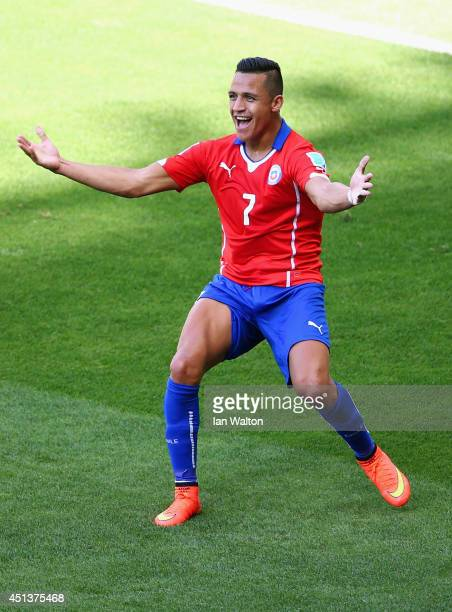 Alexis Sanchez of Chile celebrates scoring his team's first goal during the 2014 FIFA World Cup Brazil round of 16 match between Brazil and Chile at...
