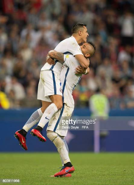 Alexis Sanchez of Chile celebrates with Arturo Vidal of Chile after scoring a penalty goal during the FIFA Confederations Cup semifinal match between...