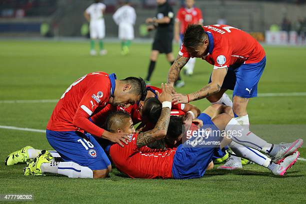 Alexis Sanchez of Chile celebrates with teammates after scoring the second goal of his team during the 2015 Copa America Chile Group A match between...