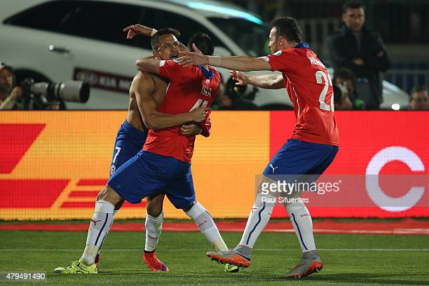 Alexis Sanchez of Chile celebrates with teammates Mauricio Isla and Angelo Enriquez after winning the 2015 Copa America Chile Final match between...