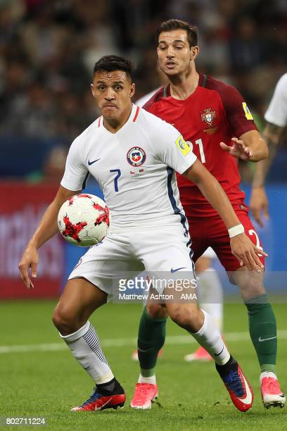 Alexis Sanchez of Chile competes with Cedric Soares of Portugal during the FIFA Confederations Cup Russia 2017 SemiFinal match between Portugal and...