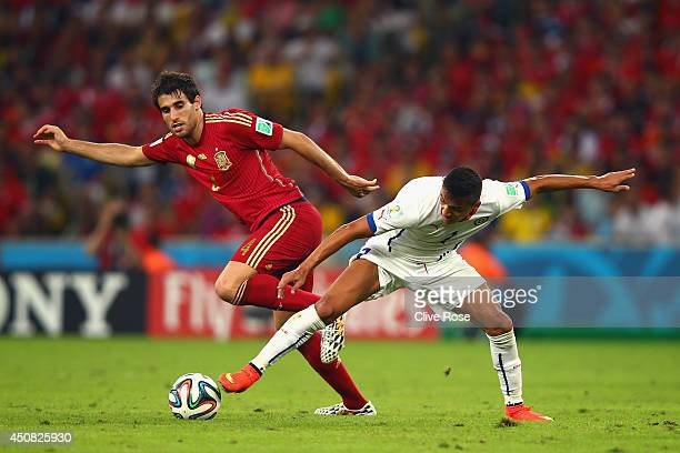 Alexis Sanchez of Chile controls the ball against Javi Martinez of Spain during the 2014 FIFA World Cup Brazil Group B match between Spain and Chile...