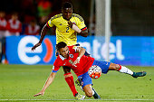 Alexis Sanchez of Chile fights for the ball with Cristian Zapata of Colombia during a match between Chile and Colombia as a part of FIFA 2018 World...