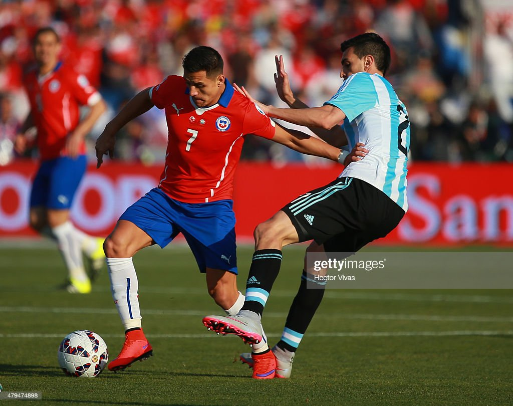 Alexis Sanchez of Chile fights for the ball with Javier Pastore of Argentina during the 2015 Copa America Chile Final match between Chile and Argentina at Nacional Stadium on July 04, 2015 in Santiago, Chile.