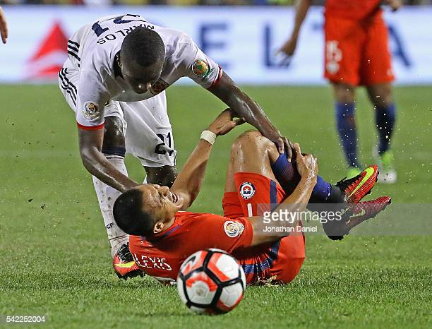 Alexis Sanchez of Chile grabs his leg after being taken down by Marlos Moreno of Colombia during a semifinal match in the 2016 Copa America...
