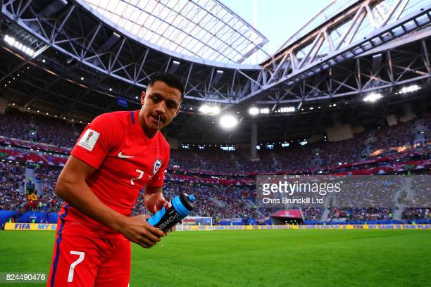 Alexis Sanchez of Chile has a drink before the FIFA Confederations Cup Russia 2017 Final match between Chile and Germany at Saint Petersburg Stadium...