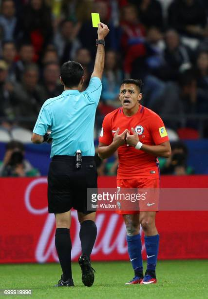 Alexis Sanchez of Chile is shown a yellow card by Referee Alireza Faghani during the FIFA Confederations Cup Russia 2017 Group B match between...