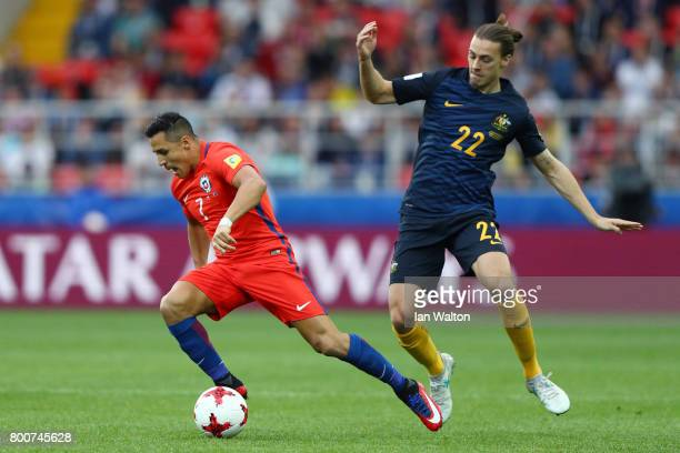 Alexis Sanchez of Chile is tackled by Jackson Irvine of Australia during the FIFA Confederations Cup Russia 2017 Group B match between Chile and...