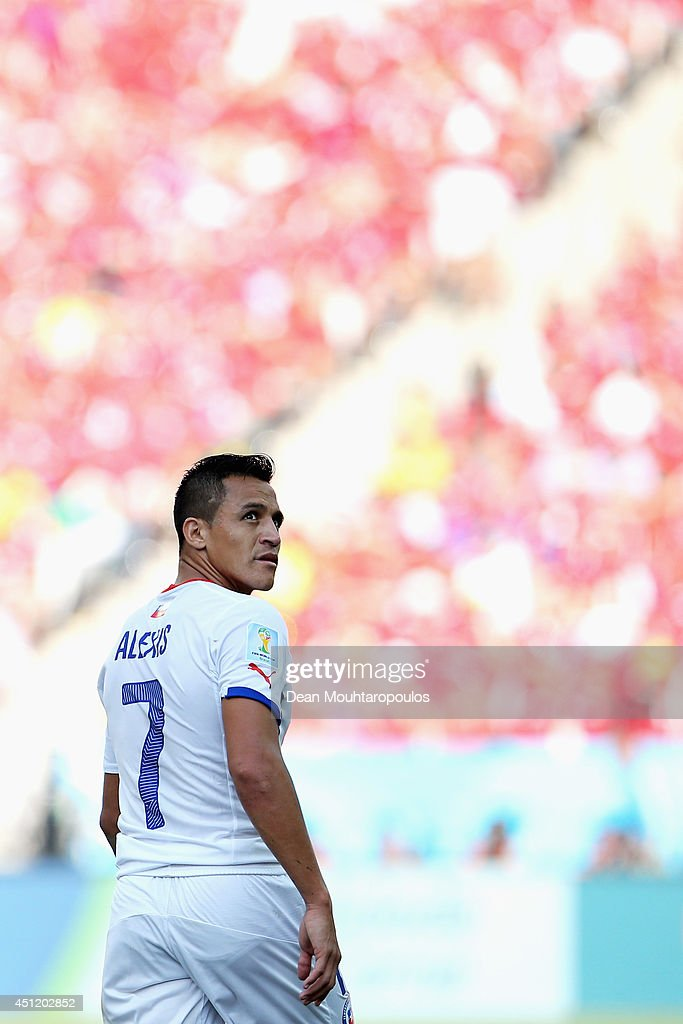 <a gi-track='captionPersonalityLinkClicked' href=/galleries/search?phrase=Alexis+Sanchez&family=editorial&specificpeople=5515162 ng-click='$event.stopPropagation()'>Alexis Sanchez</a> of Chile looks on during the 2014 FIFA World Cup Brazil Group B match between the Netherlands and Chile at Arena de Sao Paulo on June 23, 2014 in Sao Paulo, Brazil.