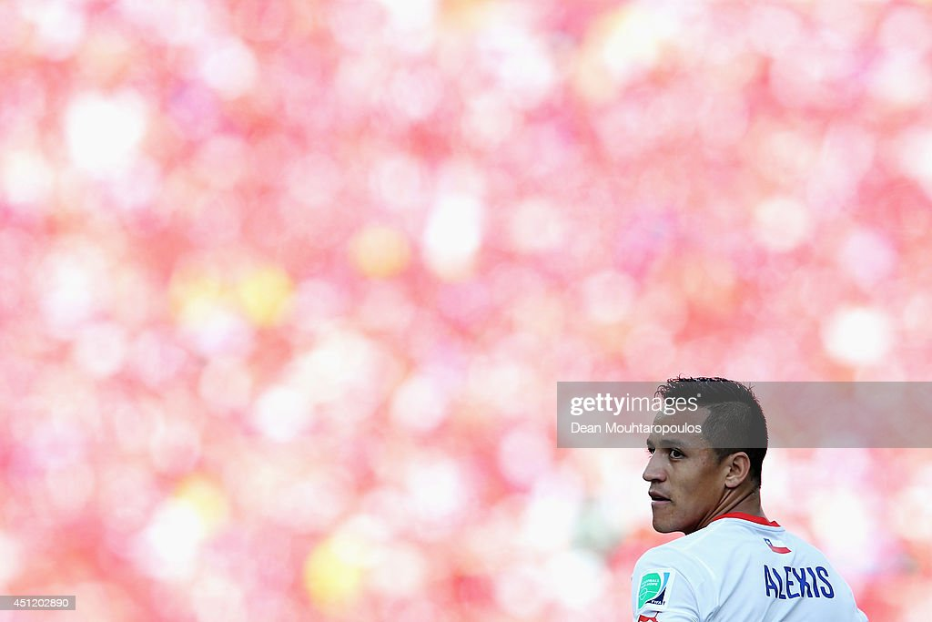 Alexis Sanchez of Chile looks on during the 2014 FIFA World Cup Brazil Group B match between the Netherlands and Chile at Arena de Sao Paulo on June 23, 2014 in Sao Paulo, Brazil.