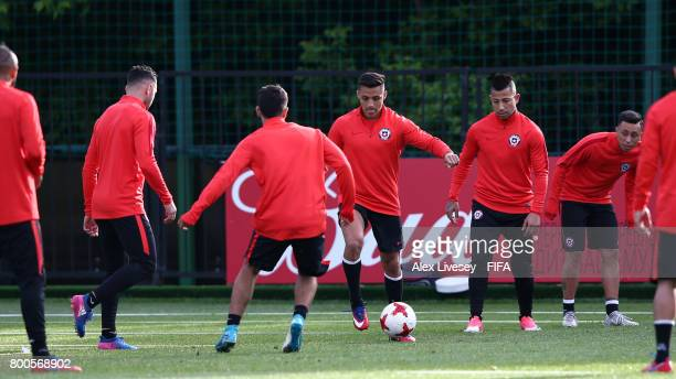 Alexis Sanchez of Chile passes the ball during a training session at the Strogino Training Ground during the FIFA Confederations Cup Russia 2017 on...