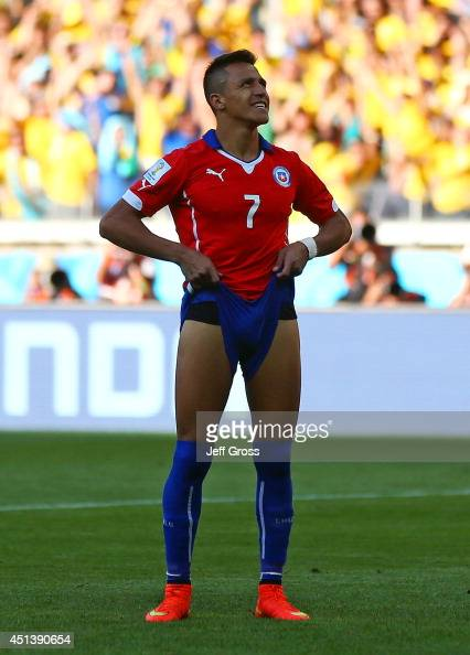 Alexis Sanchez of Chile reacts after being defeated by Brazil in a penalty shootout during the 2014 FIFA World Cup Brazil round of 16 match between...