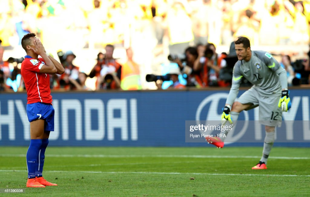 Alexis Sanchez of Chile reacts after his penalty kick saved by Julio Cesar of Brazil in a penaly shootout during the 2014 FIFA World Cup Brazil Round of 16 match between Brazil and Chile at Estadio Mineirao on June 28, 2014 in Belo Horizonte, Brazil.