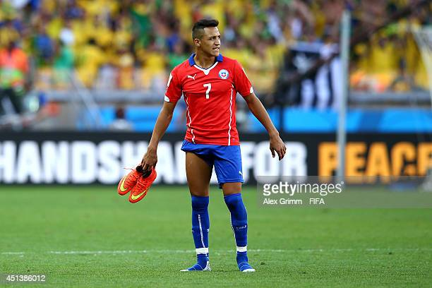Alexis Sanchez of Chile reacts after the defeat in the 2014 FIFA World Cup Brazil Round of 16 match between Brazil and Chile at Estadio Mineirao on...