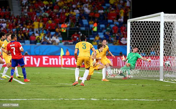 Alexis Sanchez of Chile scores a goal during the 2014 FIFA World Cup Brazil Group B match between Chile and Australia at Arena Pantanal on June 13...