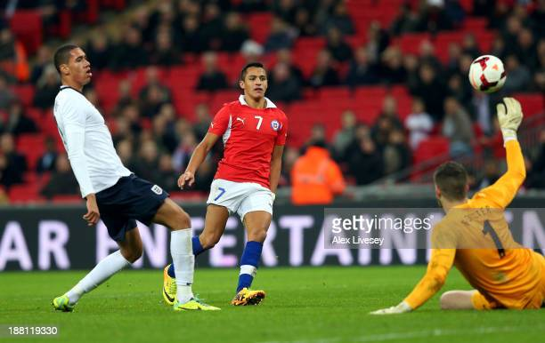 Alexis Sanchez of Chile scoring his second goal during the international friendly match between England and Chile at Wembley Stadium on November 15...