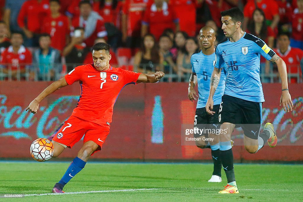 Alexis Sanchez of Chile shoots to score the second goal of his team during a match between Chile and Uruguay as part of FIFA 2018 World Cup Qualifiers at Nacional Julio Martinez Pradanos Stadium on November 15, 2016, in Santiago, Chile.