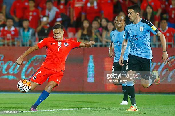 Alexis Sanchez of Chile shoots to score the second goal of his team during a match between Chile and Uruguay as part of FIFA 2018 World Cup...