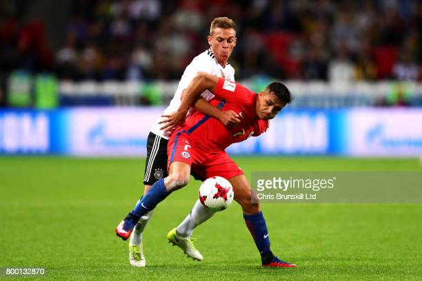 Alexis Sanchez of Chile tangles with Joshua Kimmich of Germany during the FIFA Confederations Cup Russia 2017 Group B match between Germany and Chile...