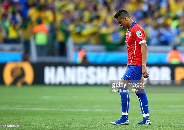 Alexis Sanchez of Chile walks off the pitch after the defeat in the 2014 FIFA World Cup Brazil Round of 16 match between Brazil and Chile at Estadio...