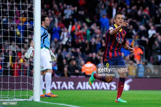Alexis Sanchez of FC Barcelona celebrates after scoring his team's third goal during the La Liga match between FC Barcelona and Elche FC at Camp Nou...